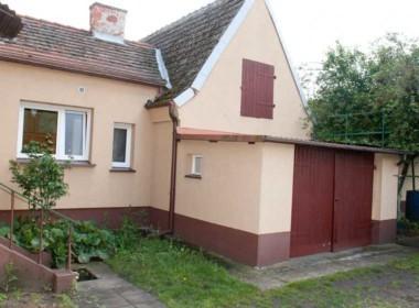 mieszkanie z ogrodem i garażem